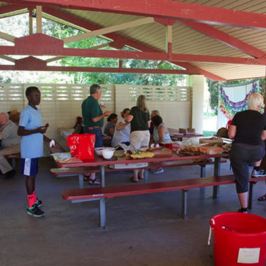 fellowship around the picnic tables